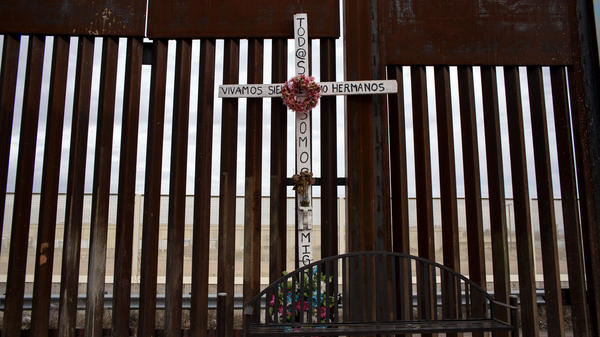 A cross in honor of dead migrants next to the border fence on the U.S./Mexico border in Agua Prieta, northwestern Mexico.