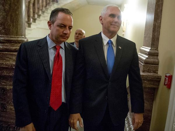 Vice President Mike Pence, right, and White House Chief of Staff Reince Priebus arrive on Capitol Hill on Tuesday for the Senate procedural vote on health care overhaul.