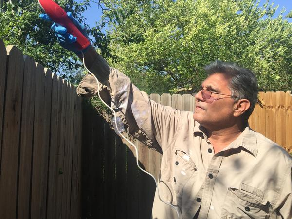 In November 2016, a Brownsville man sprays for mosquitos in his backyard after hearing news of locally-aquired cases of Zika in Cameron County.
