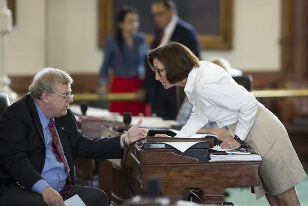 "State Sen. Lois Kolkhorst, R-Brenham, talks with Sen. Paul Bettencourt, R-Houston, during the discussion of Senate Bill 3, a so-called ""bathroom bill,"" on Tuesday."