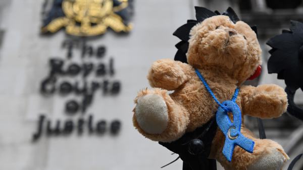 A teddy bear was set up by supporters of the family of British baby Charlie Gard outside the Royal Courts of Justice in London on Monday. After months of legal conflict over whether an experimental treatment might help Charlie or would only cause suffering, the baby will be transferred to a hospice facility to die.