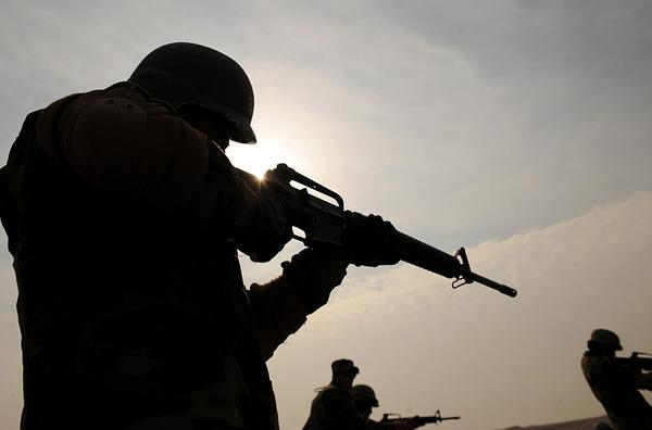 Afghan soldiers, armed with U.S.-made M-16 rifles, take part in combat training in 2009. (Shah Marai/AFP/Getty Images)