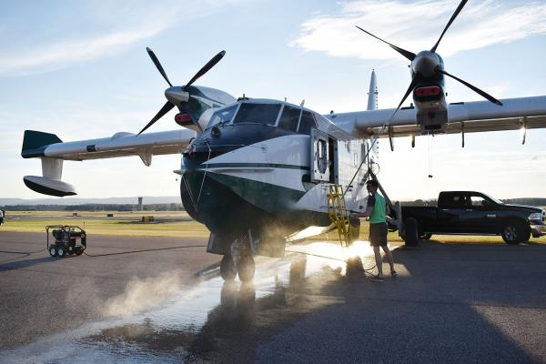 "Saskatchewan's CL215, or ""super scooper,"" is decontaminated of potential invasive species after fighting the Bridge Coulee Fire on the east side of the continental divide."