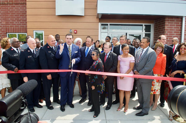 Leaders prepare to cut the ribbon in front of the Ferguson Community Empowerment Center on Wednesday. It's on the site of the QuikTrip that was burned during protests following Michael Brown's fatal shooting.