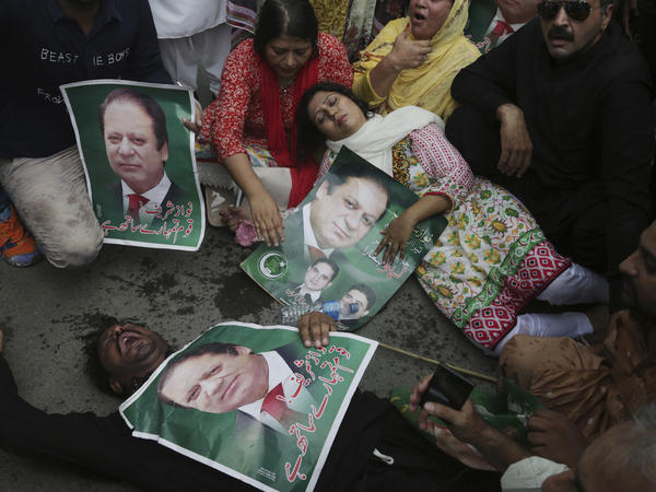Nawaz Sharif's supporters protested his ouster in Lahore on Friday.