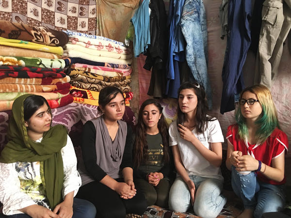 Malala meets with Yazidi teenagers near Dohuk in the Kurdistan region of Iraq. Members of this ancient religious minority were targeted by ISIS. Militants killed Yazidi men and kidnapped and enslaved girls and women. The families are still displaced and children have struggled to go to school.
