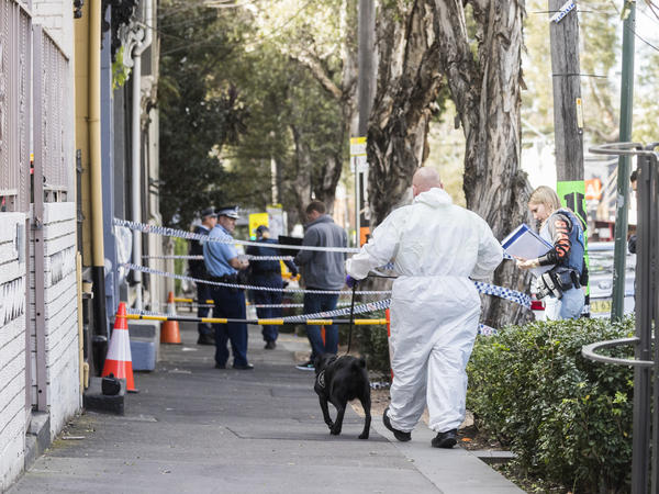Police at the scene of overnight terror raids in Surry Hills on Sunday in Sydney. Counterterrorism police raided five properties in the city's suburbs on Saturday night and arrested four men over an alleged terror plot that involved blowing up an aircraft.