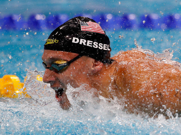 American swimmer Caeleb Dressel clinched seven gold medals at the world championships on Sunday, tying a record set by Michael Phelps. Above, Dressel races in the Men's 4x100m Medley Relay Final.