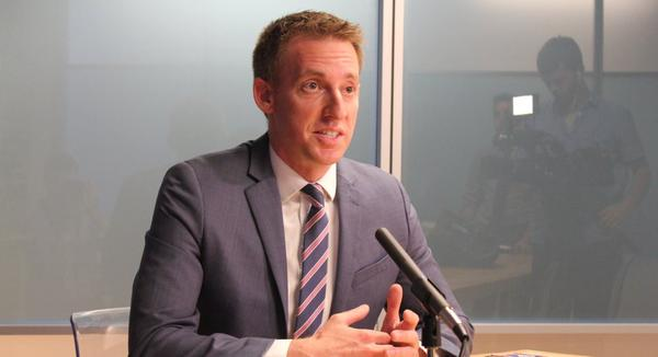 Jason Kander speaks during a recent stop in Lawrence.