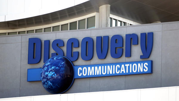 A 2010 photo shows the Discovery Communications networks headquarters building sign in Silver Spring, Md. Discovery Communications is buying media company Scripps Networks Interactive Inc. in a cash-and-stock deal worth nearly $12 billion, it announced Monday.