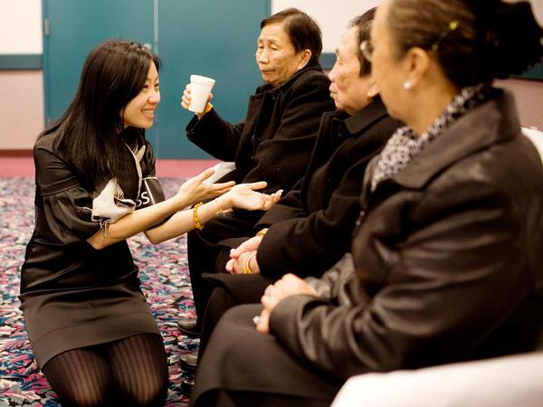 NPR reporter Doualy Xaykaothao speaks with her great-aunts — Gen. Vang Pao's sisters — in Fresno, Calif.