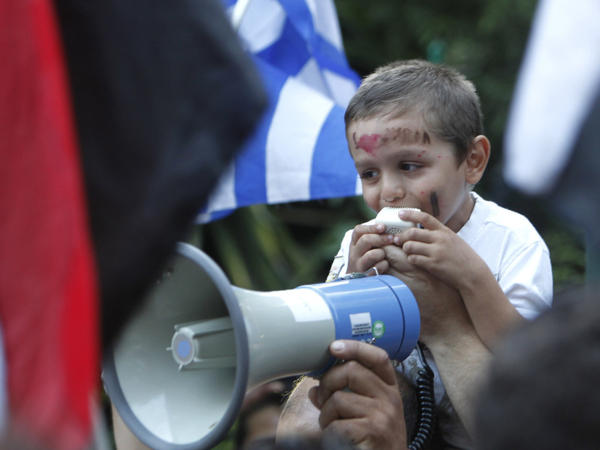 A young Syrian who lives in Greece shouts slogans during a protest outside the Syrian embassy in Athens, Tuesday, Aug. 2, 2011. About 80 people gathered outside the embassy as Syrian troops killed nearly 100 people in two days, firing at worshippers heading to Ramadan prayers in the city on Hama, an opposition stronghold.