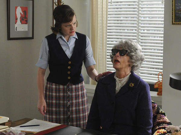 <em>Mad Men</em> leading lady Peggy Olson (Elisabeth Moss, left), discovers the expired Miss Blankenship (Randee Heller).