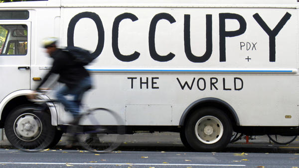 <p>The Occupy Wall Street protests have inspired similar events around America, and in dozens of countries. Here, a truck has been painted with a sign supporting the Occupy Portland protests in Oregon.</p>