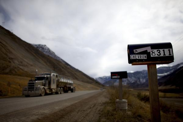 A water truck drives down a rural road in Colorado's vast Garfield County.
