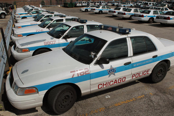 Ford Crown Victorias sit in a parking lot outside a police station in Chicago. Sales of the Crown Victoria more than doubled in August as police departments stockpiled the popular fleet vehicle before Ford ended its production this week.