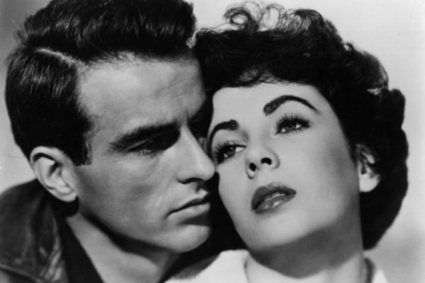 Montgomery Clift and Taylor star in the melodrama <i>A Place In The Sun<i>.