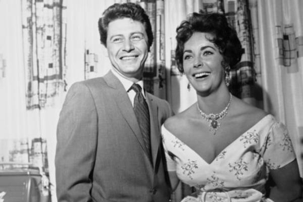Taylor with her fourth husband, Eddie Fisher. Fisher divorced his wife, Debbie Reynolds, to marry Taylor, the widow of his best friend.