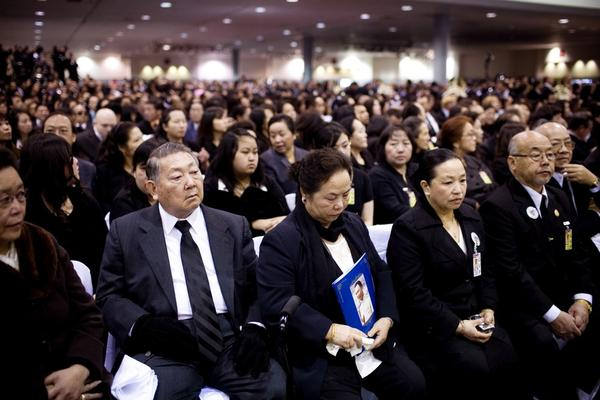 Family, friends and members of the Hmong community crowd the Fresno Convention Center for the funeral.
