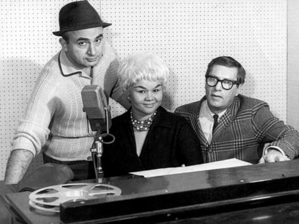 Etta James (center) poses with Phil Chess (left), founder of Chess Records, and producer Ralph Bass in 1960.