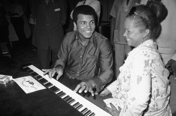 Muhammad Ali plays a few notes on the piano with Etta James while visiting black American artists that performed in the Zaire 74 music festival in Kinshasa, Zaire on Sept. 22, 1974.