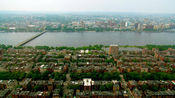 Some scientists predict that by 2050, climate change and an accompanying rise in sea level will lead to frequent flooding in Boston.