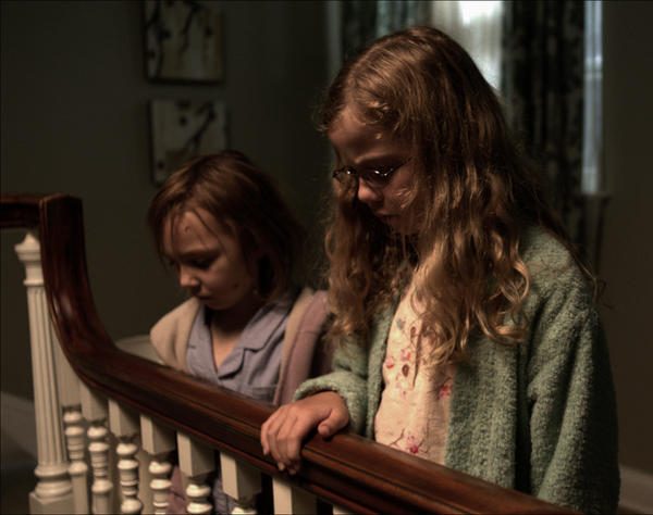 Lilly and Victoria provide a haunting presence at the heart of <em>Mama</em>, a horror film backed by executive producer Guillermo del Toro.