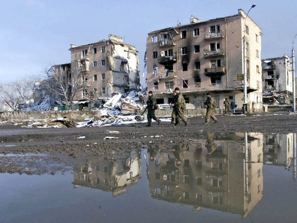 Russian troops patrol Minutka square in the Chechen capital on Monday, Feb. 28, 2000.