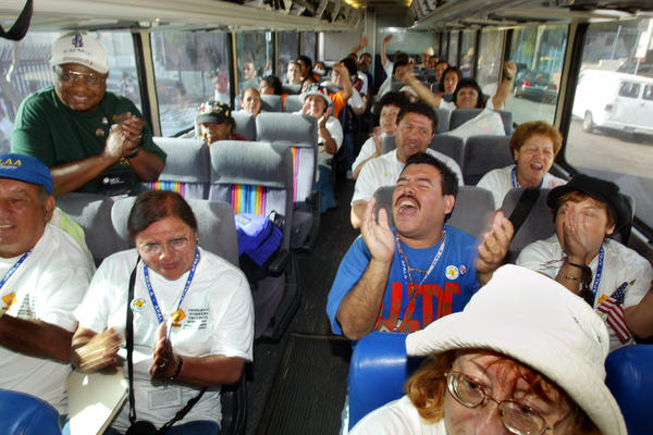 Participants in the Immigrant Workers Freedom Ride sit on a bus that will travel from Los Angeles to Washington, D.C., Sept. 23, 2003.