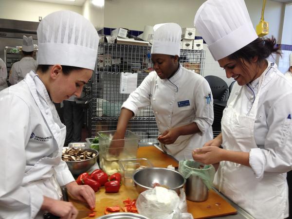 Fourth year Tulane medical school student Neha Solanki (far right) preps a Greek frittata during a class at Johnson & Wales.