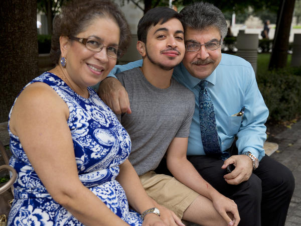 "Younes with his mother, Lina, and father, Badri. ""At certain moments, we thought, 'Why us? Why us? You know, God, we didn't need this,' "" his father said. ""But I say it now, thank God it was us."""