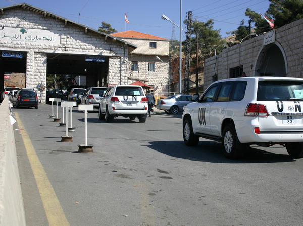 A convoy of United Nations vehicles at the Lebanon-Syria Masnaa border crossing on Oct. 1 as a chemical weapons disarmament team awaited entry into Syria.
