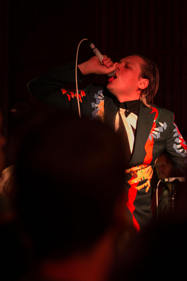 Arcade Fire's Win Butler, fronting the band in a live performance at Capitol Studios in Los Angeles, on Monday, Oct. 28, 2013.
