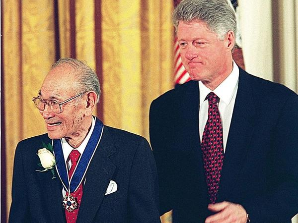 President Clinton stands with Fred Korematsu after awarding him the Presidential Medal of Freedom, the nation's highest civilian honor, at the White House in Washington, D.C., on Jan 15, 1998.