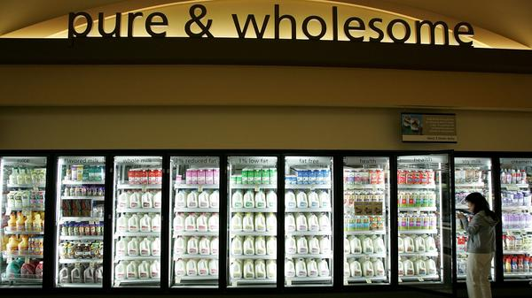 A customer shops for milk at a Safeway in Livermore, Calif. Although it may seem counterintuitive, there's growing evidence that full-fat dairy is linked to reduced body weight.