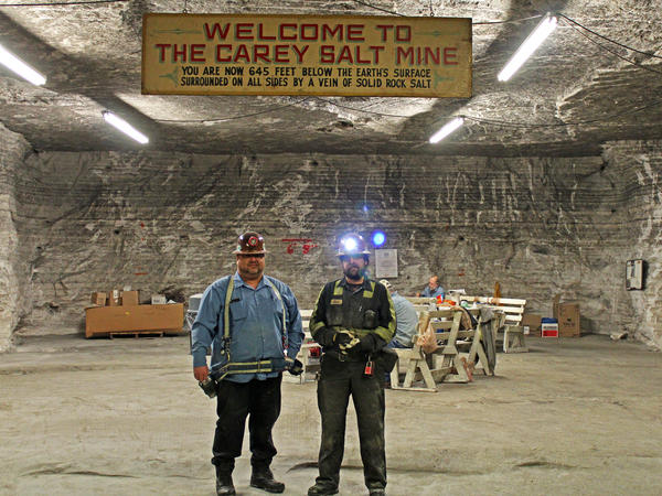 At Hutchinson Salt Co., John Kinkaid and Eric Price stand under the sign bearing the old name of the mine.