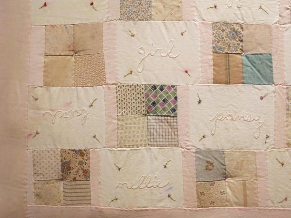 Melanie Braverman, <em>Queer, </em>1999-2000<em> </em><em>, </em>Antique fabric quilt patches, cotton thread, and silk ribbon, 64 x 49 in.