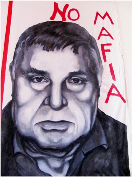 A painting of Mafia boss Salvatore Riina, on display at the Museo Anti-Mafia in Corleone, Sicily.