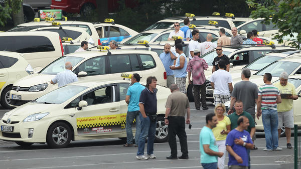 Taxi drivers gather in Berlin before joining an anti-Uber protest through the city. It coincided with similar protests in cities across Europe.