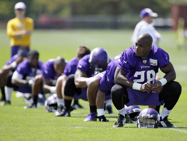 Adrian Peterson (right) was ordered to stay away from his team, the Minnesota Vikings, while he addresses child abuse charges in Texas.