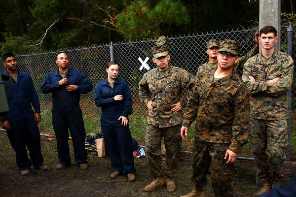 Lance Cpl. Julia Carroll stands with fellow Marines during light armored vehicle training at Camp Lejeune.