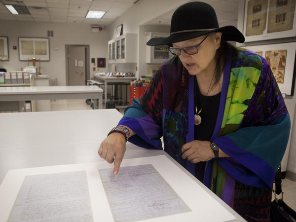 Suzan Shown Harjo points to a signature on Treaty K at the National Archives. The document will be on display in 2016 at the Smithsonian's National Museum of the American Indian for an exhibit on treaties curated by Harjo.