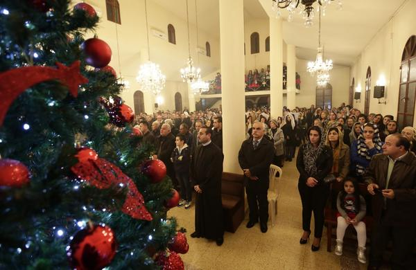 assyrian christians from iraq syria and lebanon attend a christmas mass at saint georges church