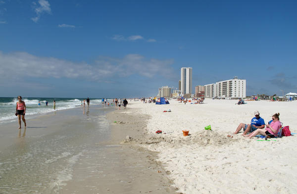 Tourists flock to the beach in Gulf Shores, Ala.
