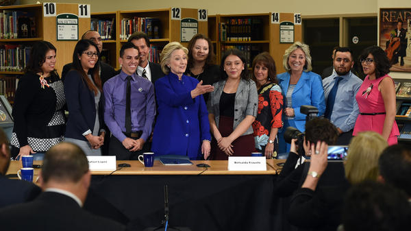 "Democratic presidential candidate Hillary Clinton spoke Tuesday  with DREAMers including Juan Salazar (second from right) and Astrid Silva (left). ""I will fight to stop partisan attacks on the executive actions that would put DREAMers — including many with us today — at risk of deportation,"" Clinton said."