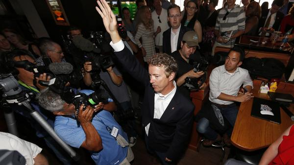 Sen. Rand Paul waves to supporters in Denver after he spoke to a closed meeting of cannabis business leaders earlier in the day.