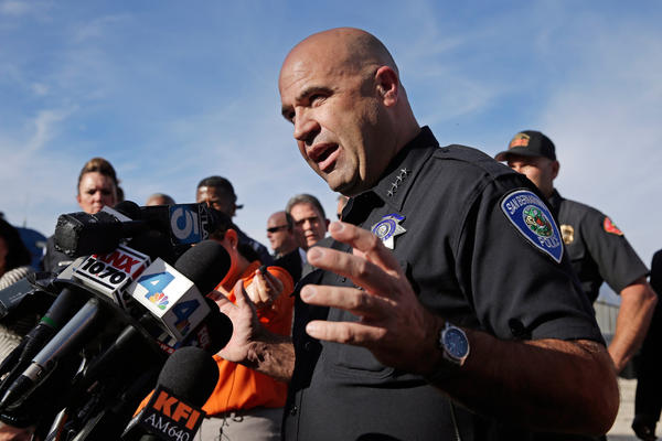San Bernardino Police Chief Jarrod Burguan says the suspects fled in a potentially dark-colored SUV.