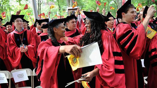 Graduates celebrate during commencement ceremonies at Harvard University.