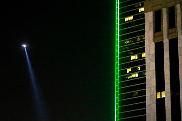 A Dallas police helicopter flies over the scene where several Dallas police officers were shot.