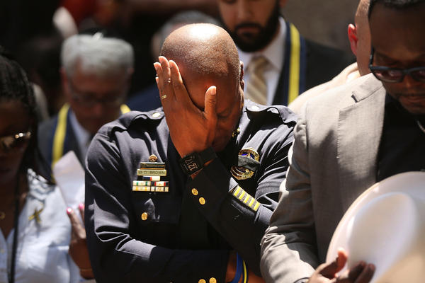 Dallas Police Chief David Brown pauses at a prayer vigil following the deaths of five police officers last night during a Black Lives Matter march.